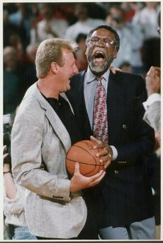 June 2, 1999:  Celtics legends Larry Bird and Bill Russell shared a laugh during legends night at Boston Garden celebrating the closing of Boston Garden.