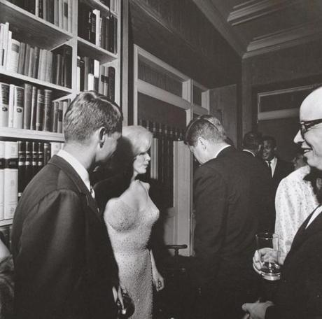 Marilyn Monroe with Robert and John Kennedy.