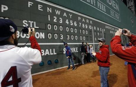 Fans took pictures of the Fenway Park scoreboard following the Red Sox victory.