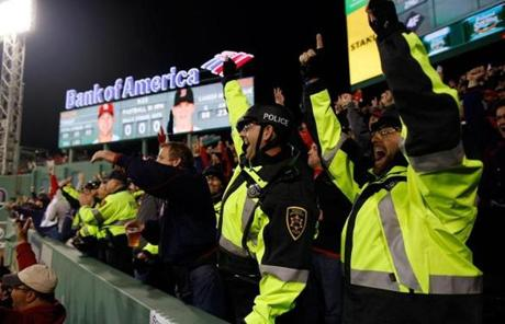 Boston University police officers cheered as the Red Sox scored in the fourth inning.