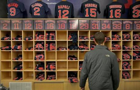 A man browsed T-shirts bearing the names of Red Sox players after the team won Game 6.