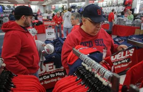 Paul Kawa of Medford gathered a pile of Red Sox gear at Modell's.