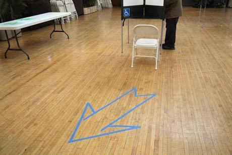 At the Veronica B. Smith Multi-Service Senior Center voters were directed where to go by an arrow on the floor.