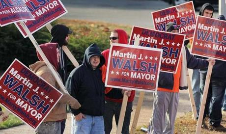 Boston, MA 110513 Members of the sheet metal union, Local 17, manned their posts this morning outside Holy Parish Hall in West Roxbury, Tuesday, November 5 2013. (Globe Staff/Wendy Maeda) section: Metro slug: 06election reporter: