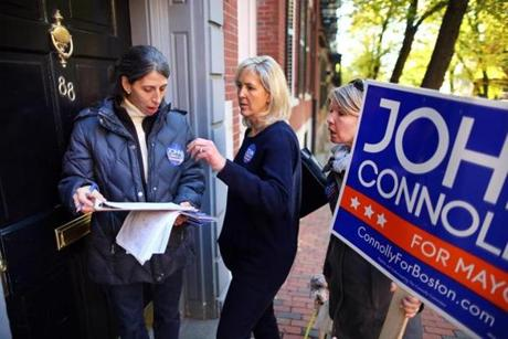 Boston-1/5/13--Connolly campaign volunteers canvased the Beacon Hill neighborhood. Ania Camargo(left) a Connolly volunteer talks volunteer and Beacon Hill resident Suzie Tapson , and Cecilia Idman-Rait(rt) as they look over voter registration lists on Mt. Vernon Street. Boston Globe Staff photo by John Tlumacki(metro)