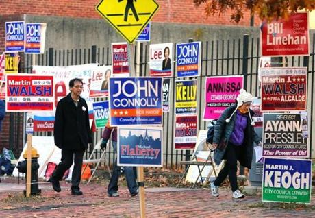 People were bombard with campaign signs at the Franklin Institute polling place on East Berkley Street in the South End.