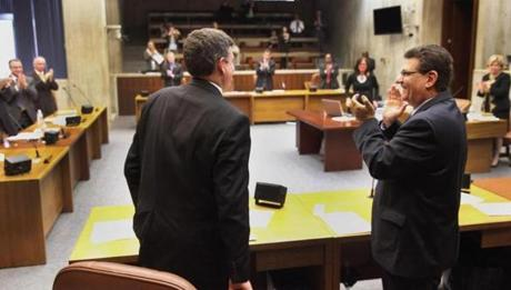 John Connolly (left) received a standing ovation from his colleagues at the end of Wednesday's City Council meeting.