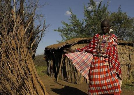 An elderly Masai woman went about her daily chores at a village in the outskirts of the Masai Mara Reserve near Bateleur Camp. This area of Kenya became world renowned  through Sydney Pollack's film