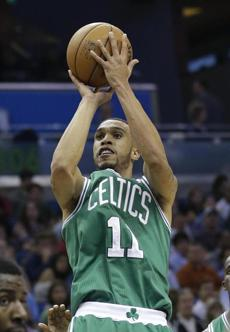 Boston Celtics' Courtney Lee (11) makes a shot against the Orlando Magic during the first half of an NBA basketball game in Orlando, Fla., Friday, Nov. 8, 2013.(AP Photo/John Raoux)