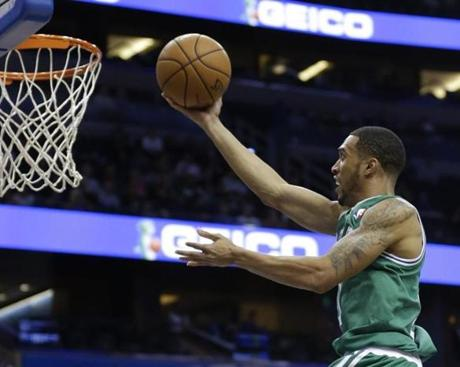 Boston Celtics' Courtney Lee (11) makes a lay up against the Orlando Magic during the first half of an NBA basketball game in Orlando, Fla., Friday, Nov. 8, 2013.(AP Photo/John Raoux)