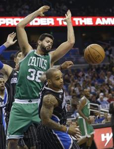 Boston Celtics' Vitor Faverani (38), of Brazil, and Orlando Magic's Jameer Nelson, right, lose control of a rebound during the first half of an NBA basketball game in Orlando, Fla., Friday, Nov. 8, 2013. (AP Photo/John Raoux)