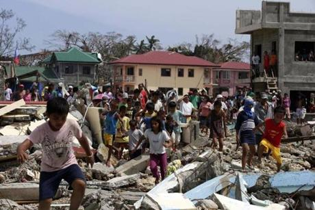 Filipino villagers ran toward government officials, hoping for food relief in the town of Hernani.