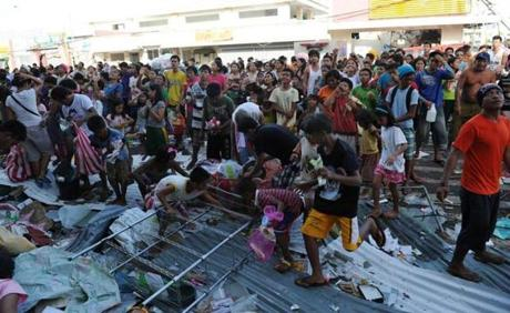 Dazed survivors begged for help and scavenged for food, water, and medicine Monday in Guiuan.
