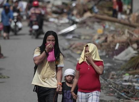 Survivors covered their noses in typhoon-ravaged Tacloban city.
