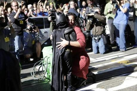 The woman hugged Batkid after he and his partner rescued her and disabled a plastic replica bomb.