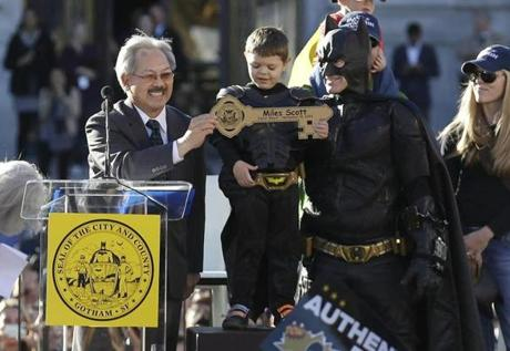 Mayor Ed Lee (left) presented Batkid with a key to the city at a rally outside City Hall.