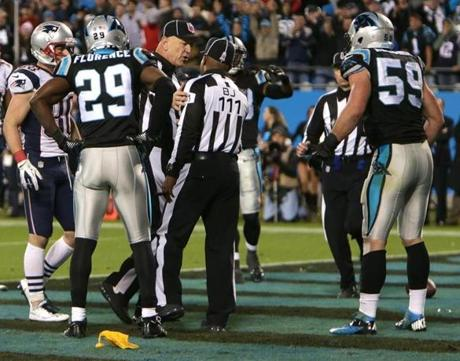 Kuechly questioned the flag while the referees confered on the field.