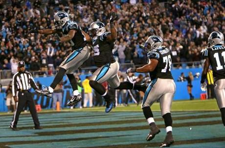 Ginn was flying high as he celebrated the touchdown in the fourth quarter.