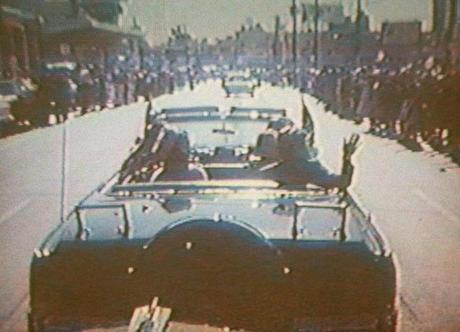 In this image taken by presidential aide Dave Powers and photographed from a television screen, President John F. Kennedy and Jacqueline Kennedy waved from his limousine in Dallas.