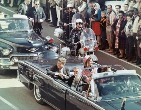 President and Mrs. John F. Kennedy smiled at the crowds lining their motorcade route in Dallas minutes before the president was assassinated.