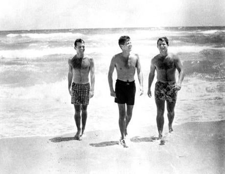 John F. Kennedy (center) on the beach with his brothers Robert (left) and Ted.
