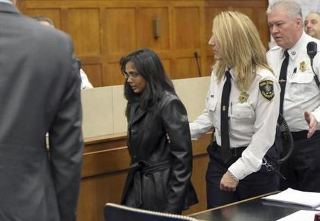 Dookhan was led away by a court officer on Friday after the hearing in Suffolk Superior Court.