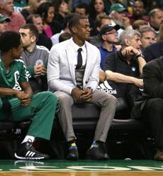 Rajon Rondo watched the game action from the bench.