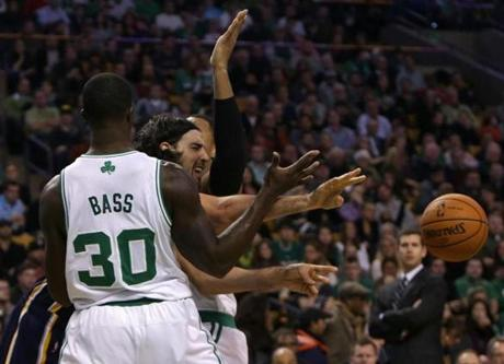 Brandon Bass (center) and Jared Sullinger doubled down on the Pacers' Luis Scola in the first half.