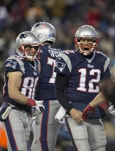 Danny Amendola and Brady reacted after Edelman's 14-yard touchdown reception.