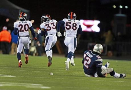 Von Miller (second from right) headed for the end zone after recovering a first-quarter fumble by Ridley (not pictured).