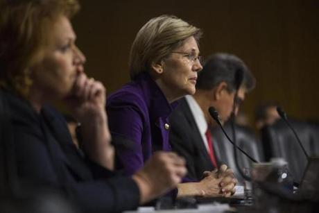 Warren (center) listened to Janet Yellen, President Obama's nominee to succeed Ben Bernanke as Federal Reserve chairman, testify at Yellen's confirmation hearing before the Senate Banking Committee.