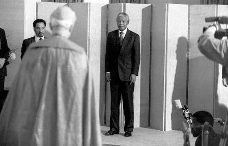 A Vatican ambassador approached Mandela to present his credentials at the president's office in Cape Town.