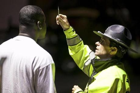 Trooper Mary Wakeham administered a sobriety test to a suspected drunk driver at a checkpoint along Route 16 in Everett.