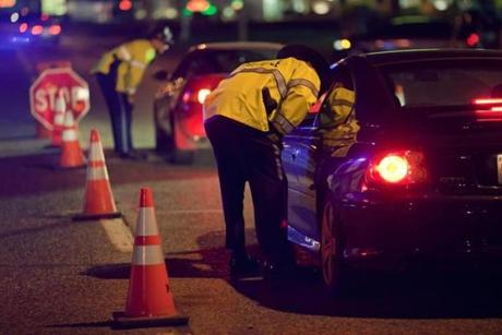 State Police troopers stopped cars at a sobriety checkpoint on Memorial Avenue in Chicopee.