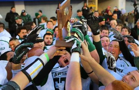 Mansfield players celebrated winning the Division 2 Super Bowl 28-14 over St. John's.