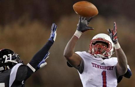 Tewksbury beat Plymouth South 42-14. Pictured: Eddie Matovu hauled in a pass in the first half.
