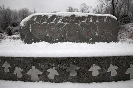 A granite memorial commemorates the 26 victims killed at Sandy Hook Elementary.