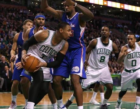 Jared Sullinger looked for an outlet as he was triple covered in the first half.