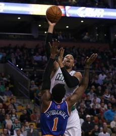 Jared Sullinger put up a shot over the Knicks' Amare Stoudemire during Friday's game at TD Garden.