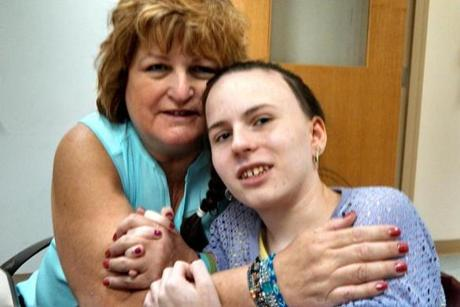 Linda Pelletier with her daughter Justina at Boston Children's Hospital, during one of her allowed weekly visits.