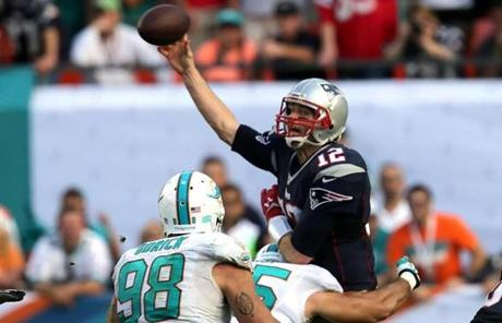 Brady had to get rid of the ball quickly as he took a hit.