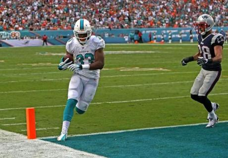 Daniel Thomas was untouched as he scored a touchdown in the third quarter.