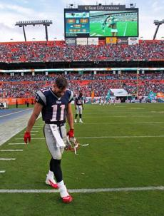 Edelman and Boyce walked off the field following the Patriots' 24-20 loss to the Dolphins.