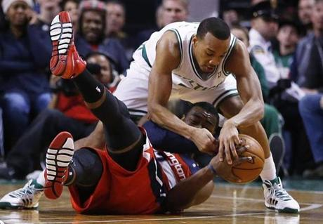 Avery Bradley played defense against John Wall in the first quarter.