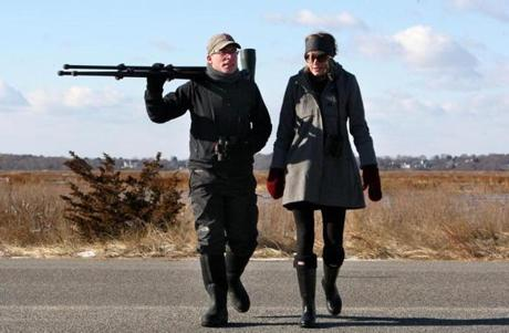 01-01-14: Plum Island, MA: Birdwatcher Neil Hayward (left) with his girlfriend Gerri Buck, at the Parker River National Wildlife Refuge on Plum Island, Mass. Jan. 1, 2014. Hayward apparently set an American Birding Association record by observing 749 different birds in 2013. Photo/John Blanding, Boston Globe staff story/Bryan Marquard, Metro ( 02hayward )