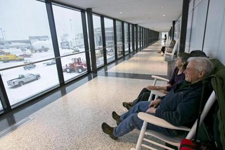 Jeff Katchen of Cornish, N.H., and his wife, Eileen, of waited at Logan Airport on Thursday for their delayed JetBlue flight to Richmond, Va.
