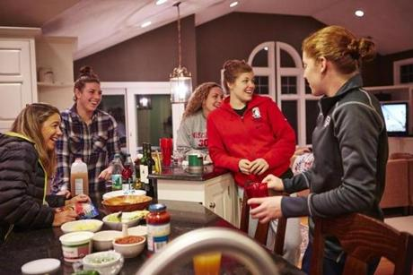 At her Concord home, mom Kris Miller hosts burrito night for players Hilary Knight, Jessie Vetter, Anne Schleper, and Molly Schaus.