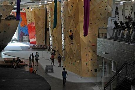 Coworking space has caught on in a big way in Greater Boston, though not everyone needs rock climbing nearby, such as at Brooklyn Boulders.