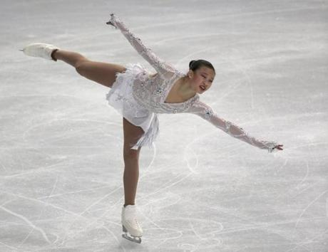 Wellesley-based costume designer Yumi Barnett-Nakamura, who has worked with skater and Harvard student Christina Gao (pictured), work closely with skaters and coaches during the designing process.