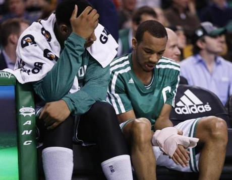 Avery Bradley looked at a bandaged hand with forward Jared Sullinger. Bradley continued playing in the game.
